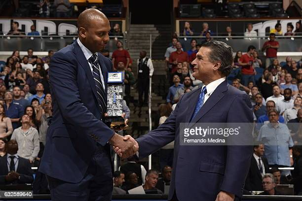 Anfernee 'Penny' Hardaway is presented with an award by Alex Martins for being inducted into the Orlando magic's team hall of fame on January 20 2017...