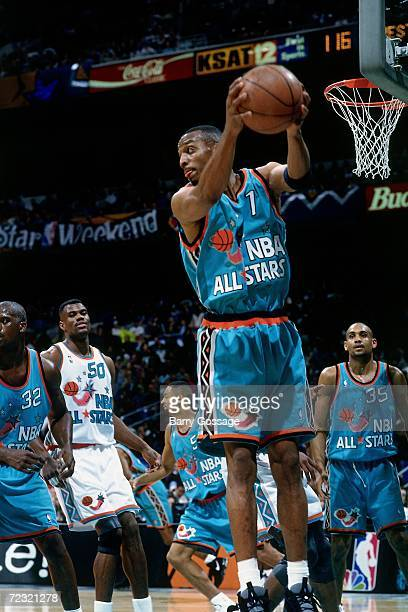 Anfernee Penny Hardaway of the Eastern Conference All Stars grabs a rebound during the 1996 NBA All Star Game played on February 11 1996 at the Alamo...