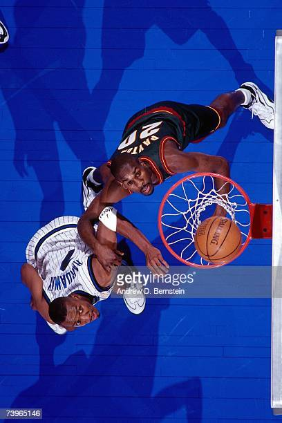Anfernee 'Penny' Hardaway of the Eastern Conference boxes out against Gary Payton of the Western Conference during the 1997 AllStar Game on February...