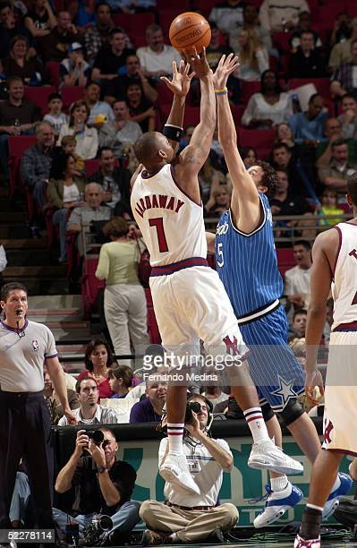 Anfernee Penny Hardaway of the New York Knicks shoots against Hedo Turkoglu of the Orlando Magic on March 4 2005 at TD Waterhouse Centre in Orlando...