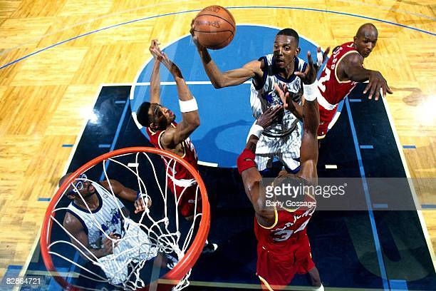 Anfernee Penny Hardaway of the Orlando Magic goes up for a shot against Hakeem Olajuwon of the Houston Rockets during Game One of the 1995 NBA Finals...
