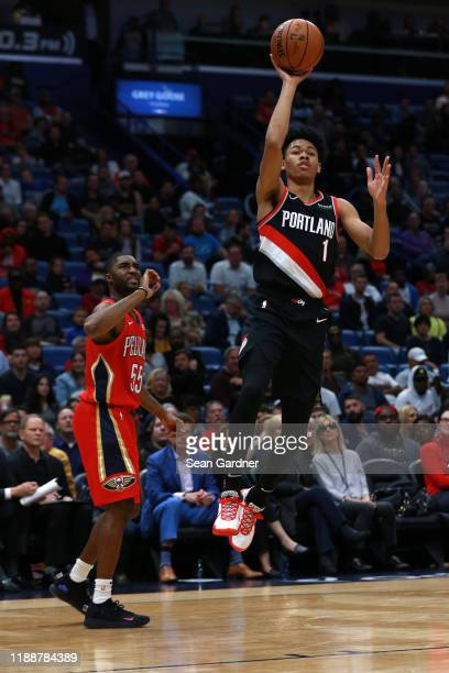 Anfernee Simons of the Portland Trail Blazers shoots over E'Twaun Moore of the New Orleans Pelicans during a NBA game at the Smoothie King Center on...