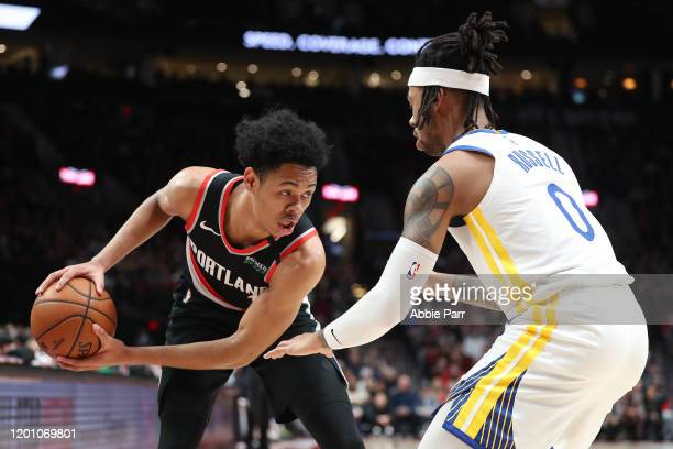 Anfernee Simons of the Portland Trail Blazers works against D'Angelo Russell of the Golden State Warriors in the first quarter during their game at...