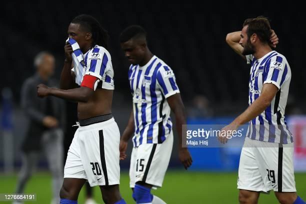 Anga Dedryck Boyata, Jhon Cordoba and Lucas Tousart of Berlin react after the Bundesliga match between Hertha BSC and Eintracht Frankfurt at...
