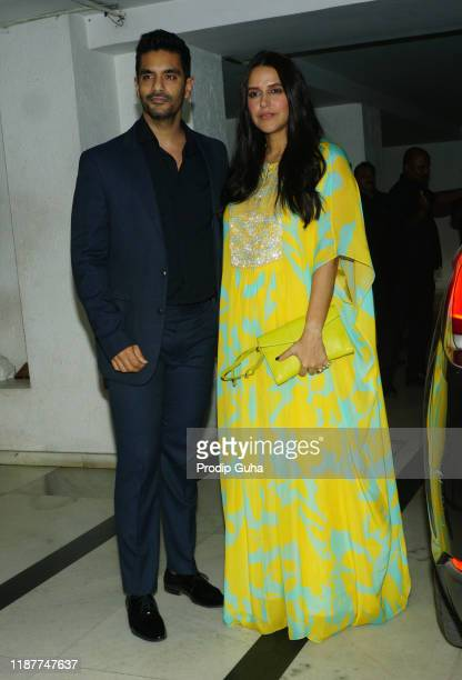 Angad Bedi and Neha Dhupia attend the party for Katy Perry hosted by Karan Johar on November 14, 2019 in Mumbai, India.