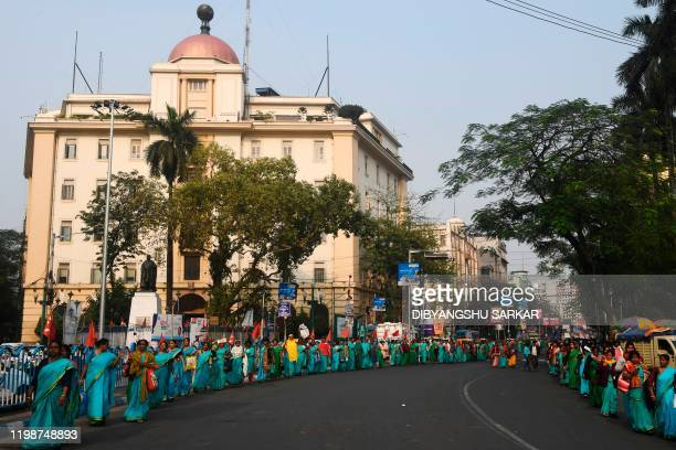 Anganwadi workers a governmentsponsored child and mother care from various districts of West Bengal state participate in a rally to demand more...