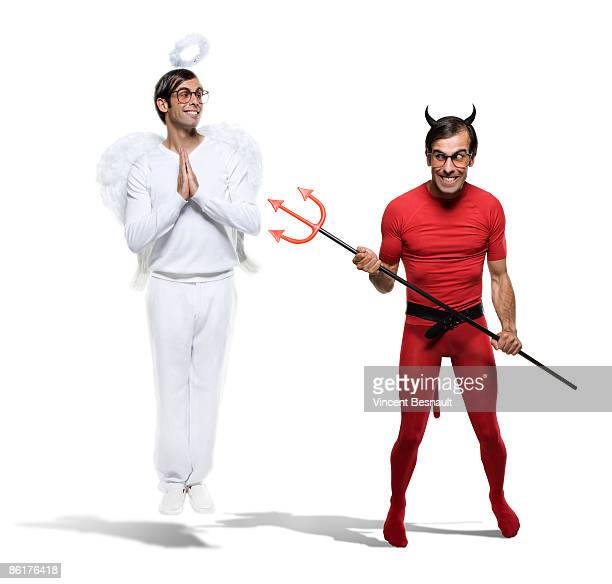 ange & demon 1.tif - devil costume stock photos and pictures
