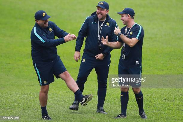Ange Postecoglou coach of Australia and staff coaches joke during a training session ahead of the leg 1 of FIFA World Cup Qualifier Playoff against...