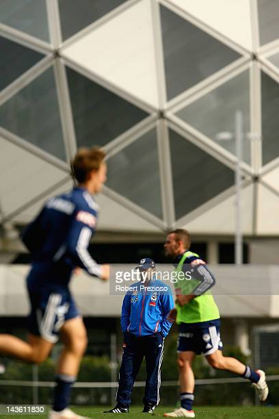 Ange Postecoglou looks on during a Melbourne Victory ALeague training session at Gosch's Paddock on May 1 2012 in Melbourne Australia