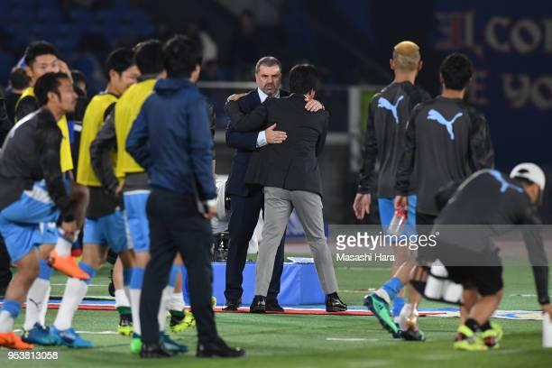Ange Postecoglou of Yokohama FMarinos and Hiroshi Nanamicoach of Jubilo Iwata hug after the JLeague J1 match between Yokohama FMarinos and Jubilo...