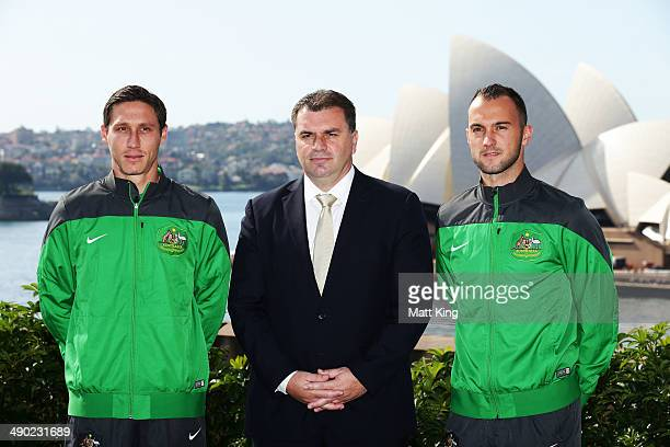 Ange Postecoglou poses with Socceroos players Mark Milligan and Ivan Franjic during the Socceroos 2014 FIFA World Cup Preliminary Squad Announcement...