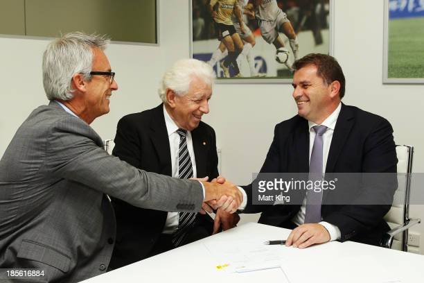 Ange Postecoglou shakes hands with FFA CEO David Gallop and FFA Chairman Frank Lowy before a press conference at the FFA Headquarters on October 23,...