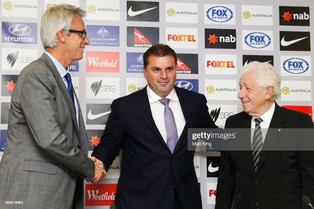 Ange Postecoglou (C) shakes hands with FFA CEO David Gallop (L) and FFA Chairman Frank Lowy (R) during a press conference at the FFA Headquarters on October 23, 2013 in Sydney, Australia. The FFA today announced Postecoglou as the Socceroos new head coach through to the 2018 World Cup.