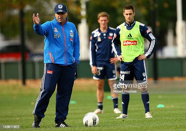 Ange Postecoglou talks to his players during a Melbourne Victory ALeague training session at Gosch's Paddock on May 1 2012 in Melbourne Australia