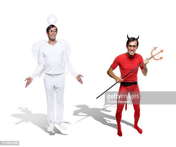 angel and devil side by side - devil costume stock photos and pictures