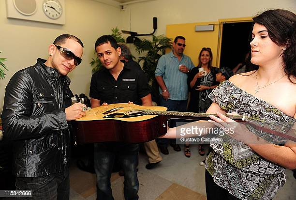 Angel and Khriz attends the Latin GRAMMY in the Schools at Miami Coral Park Senior High School on October 9 2009 in Miami Florida