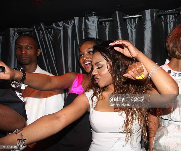Angel and Lil' Kim attend Lil' Kim's Birthday Party at Spotlight Live on August 3, 2008 in New York City.
