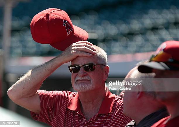 Angel assistant trainer Rick Smith has been with the team for 39 years. He performs his duties during an offf-day workout at Angel Stadium.