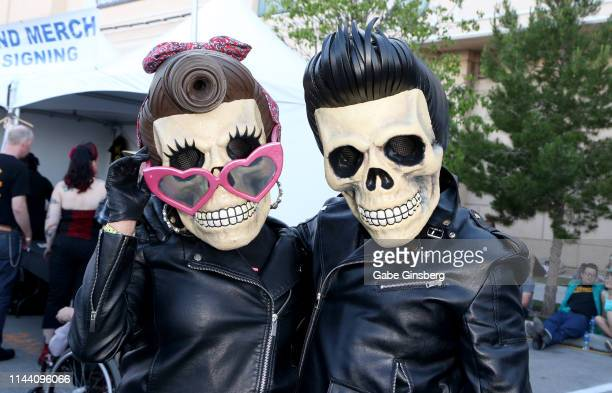 Angel Bebe and artist Luis Projects dressed as Skull Head Rockabilly characters attend the Viva Las Vegas Rockabilly Weekend car show at the Orleans...