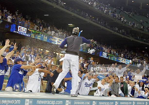 Angel Berroa of the Los Angeles Dodgers celebrates with the fans after clinching the National League West title after the game against the San Diego...