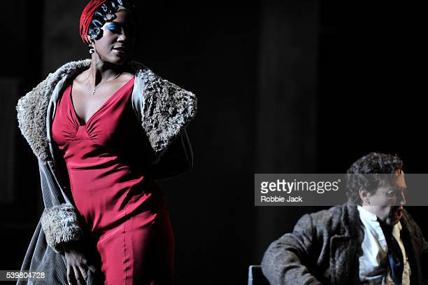 Angel Blue as Musetta and Richard Burkhard as Marcello in the English National Opera's production of Giacomo Puccini's La boheme directed by Jonathan...