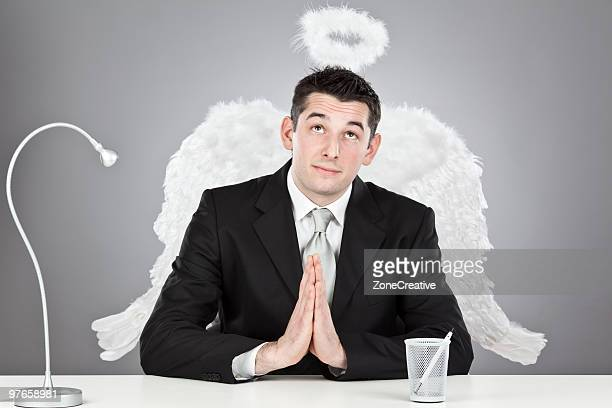 angel businessman praying portrait