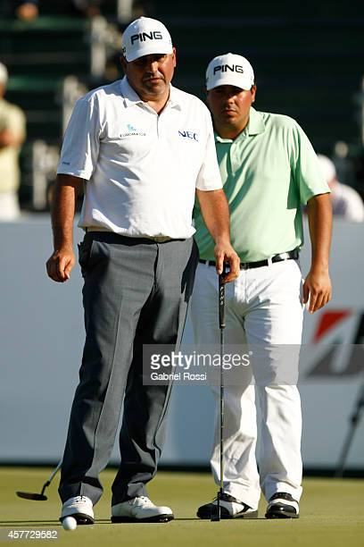 Angel Cabrera of Argentina and his son Federico Cabrera look at the ball on the green of the 18th hole during the first round of America's Golf Cup...