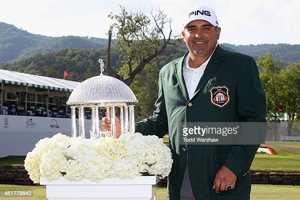 Angel Cabrera of Argentina holds the trophy after winning the Greenbrier Classic at the Old White TPC on July 6, 2014 in White Sulphur Springs, West...