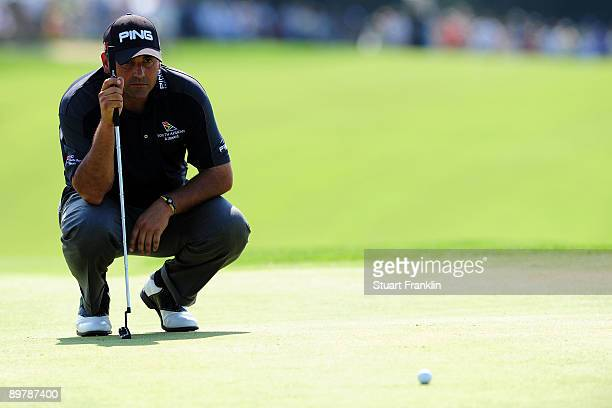 Angel Cabrera of Argentina lines up a putt on the 18th green during the second round of the 91st PGA Championship at Hazeltine National Golf Club on...