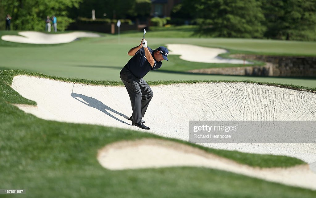 Angel Cabrera of Argentina plays from a bunker on the 7th during the second round of the Wells Fargo Championship at the Quail Hollow Club on May 2, 2014 in Charlotte, North Carolina.