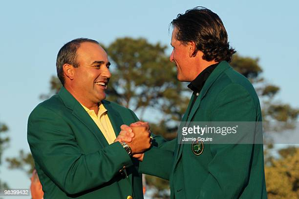 Angel Cabrera of Argentina presents Phil Mickelson with the green jacket during the green jacket presentation after the final round of the 2010...