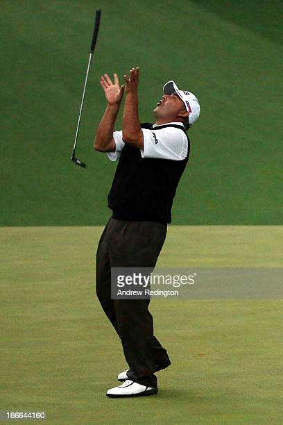 Angel Cabrera of Argentina reacts after missing a birdie putt on the second sudden death playoff hole before losing to Adam Scott of Australia in...