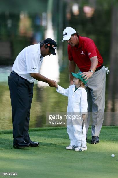 Angel Cabrera of Argentina shakes hands with Evan Mickelson son of Phil Mickelson during the Par 3 Contest at the 2008 Masters Tournament at Augusta...