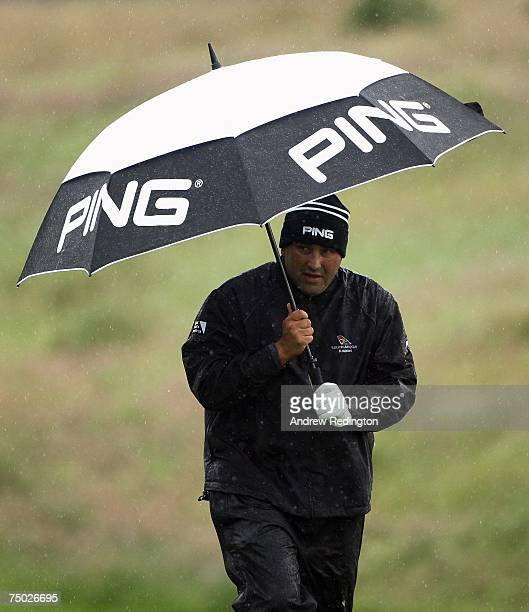 Angel Cabrera of Argentina shelters from the rain on the third hole during the ProAm for the Smurfit Kappa European Open on July 4 2007 on the...