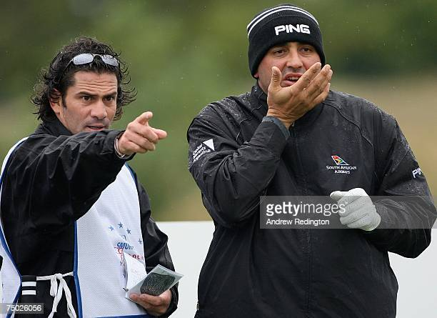 Angel Cabrera of Argentina takes advice from his caddie on the third hole during the ProAm for the Smurfit Kappa European Open on July 4 2007 on the...