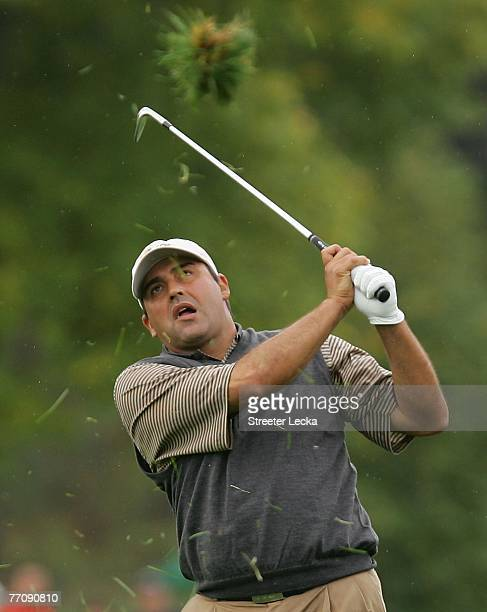 Angel Cabrera of the International Team hits a shot from the rough during the round two fourball matches at The Presidents Cup at The Royal Montreal...