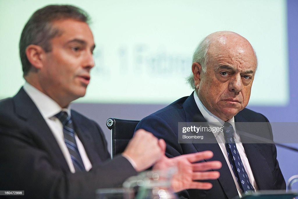 Angel Cano, president and chief operating officer of Banco Bilbao Vizcaya Argentaria SA (BBVA), left, gestures as Francisco Gonzalez, chairman of Banco Bilbao Vizcaya Argentaria SA (BBVA), listens during a news conference to announce the company's fourth-quarter results in Madrid, Spain, on Friday, Feb. 1, 2013. BBVA, Spain's second-biggest bank, posted a 20 million-euro ($27.3 million) fourth-quarter profit as a revenue boost offset costs of completing a cleanup of Spanish real estate assets. Photographer: Angel Navarrete/Bloomberg via Getty Images