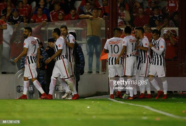 Angel Cardozo Lucena of Libertad celebrates with teammates after scoring the first goal of his team during a second leg match between Independiente...