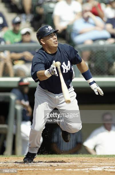 Angel Chavez of the New York Yankees follows his hit during a Spring Training game against the Atlanta Braves on March 8 2007 at The Ballpark at...
