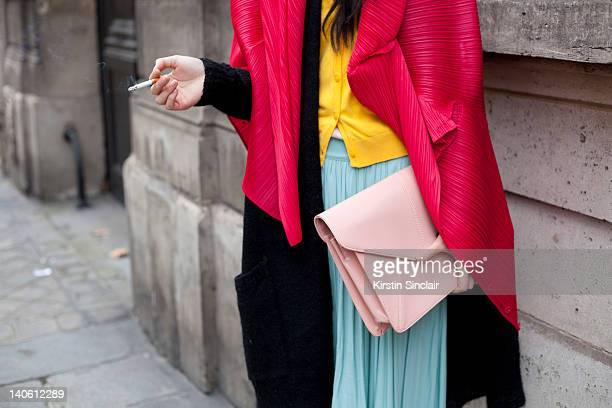 Angel Chen designer and blogger wearing Vivienne Weswood shoes Issey miyake jacket bag and sunglasses from Antwerp Vintage skirt and cardigan Cos...