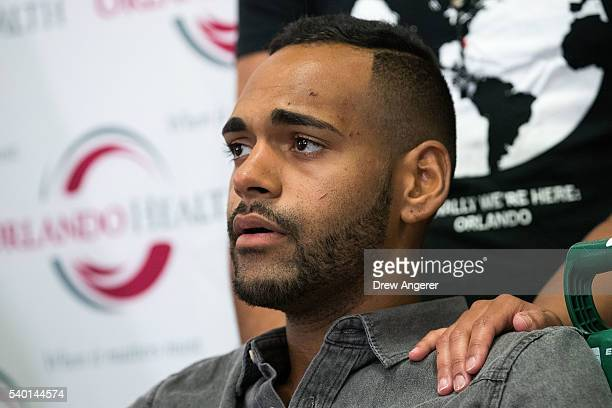 Angel Colon who was injured in the Pulse Nightclub shooting is comforted by siblings during a press conference at Orlando Regional Medical Center...