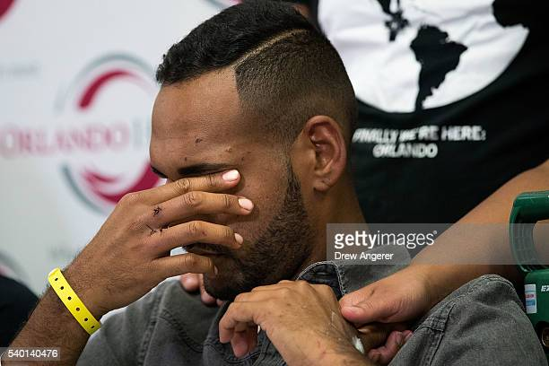 Angel Colon who was injured in the Pulse Nightclub shooting pauses during a press conference at Orlando Regional Medical Center June 14 2016 in...