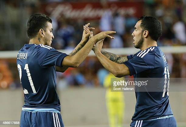 Angel Correa and Carlos Tevez of Argentina celebrate after Correa scored a goal against Bolivia during their International friendly match at BBVA...