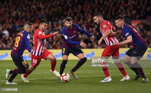 Angel Correa and Koke of Atletico Madrid battle with Jordi Alba Gerard Pique and Clement Lenglet of Barcelona during the La Liga match between FC...