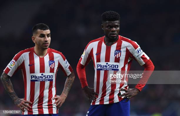 Angel Correa and Thomas Partey of Atletico Madrid line up a free kick during the Liga match between Club Atletico de Madrid and Granada CF at Wanda...