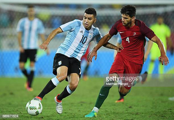 Angel Correa of Argentina and Figueiredo Tobias of Portugal battle for the ball during the Men's Group D first round match between Portugal and...