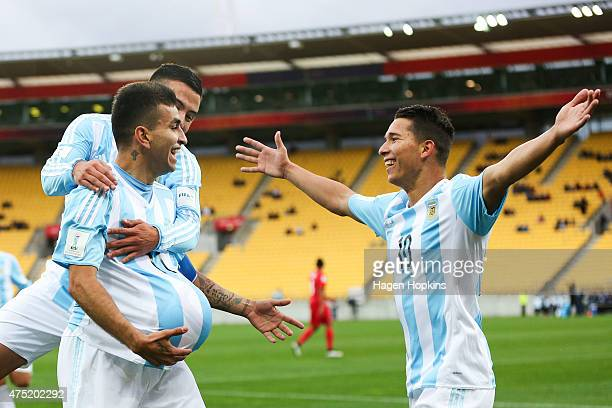 Angel Correa of Argentina celebrates his goal with Leonardo Rolon and Tomas Martinez during the Group B FIFA U20 World Cup New Zealand 2015 match...