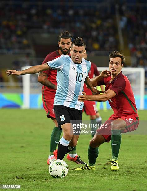 Angel Correa of Argentina controls the ball under pressure during the Men's Group D first round match between Portugal and Argentina during the Rio...