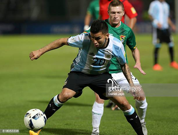 Angel Correa of Argentina dribbles past Alejandro Chumacero of Bolivia during a match between Argentina and Bolivia as part of FIFA 2018 World Cup...