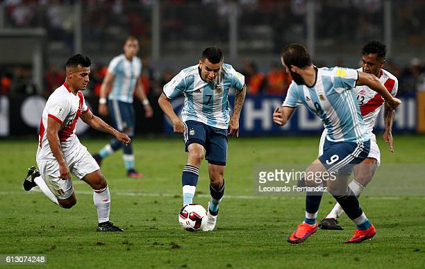 Angel Correa of Argentina drives the ball during a match between Peru and Argentina as part of FIFA 2018 World Cup Qualifiers at Nacional Stadium on...